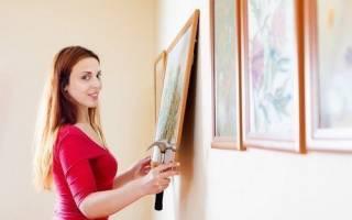 Как правильно вешать картины в квартире